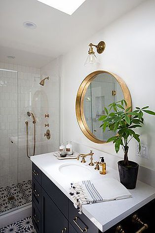 HGTV's Genevieve Gorder's favorite home decor and interior design picks for 2016 - on the Dog Lady Design Files blog! One of her favorites? Brass finishes. Brass in the bathroom is super chic against a white and navy palette. I love the ceramic painted tiles, too! Interior Design, Home Decorating and Dog Musings from Jersey City www.dogladydesignfiles.com
