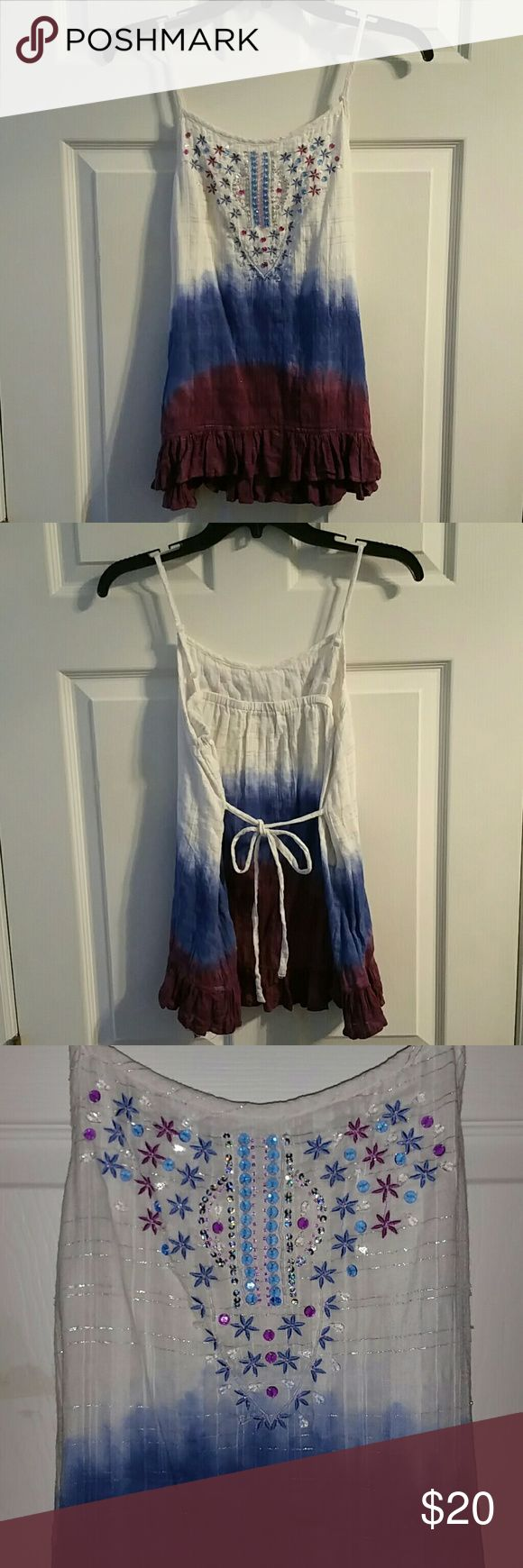 CUTE GIRLS/WOMENS TYE DYE TANK TOP BEADS&SEQUINS JUSTICE CUTE! DIPPED TYE DYE TANK TOP. EMBROIDERED FLOWERS, BEADS & SEQUINS, TIES IN THE BACK, ADJUSTABLE STRAPS, RUFFLES ON BOTTOM.WHITE, BLUES, PURPLE, AND SILVER.   SIZE: 18 XXL (GIRLS)  JUNIORS & WOMEN Are petite & XS/S will fit!  FAST SHIPPING! Same or Next Day Shipping!  SHELL: 99% Cotton 1% Other Fibers(silver threads) LINING: 100% Cotton   Worn 2 Times. Gently Laundered!  No Smoking, Buy It Now, Bundle Discounts Available, Reasonable…