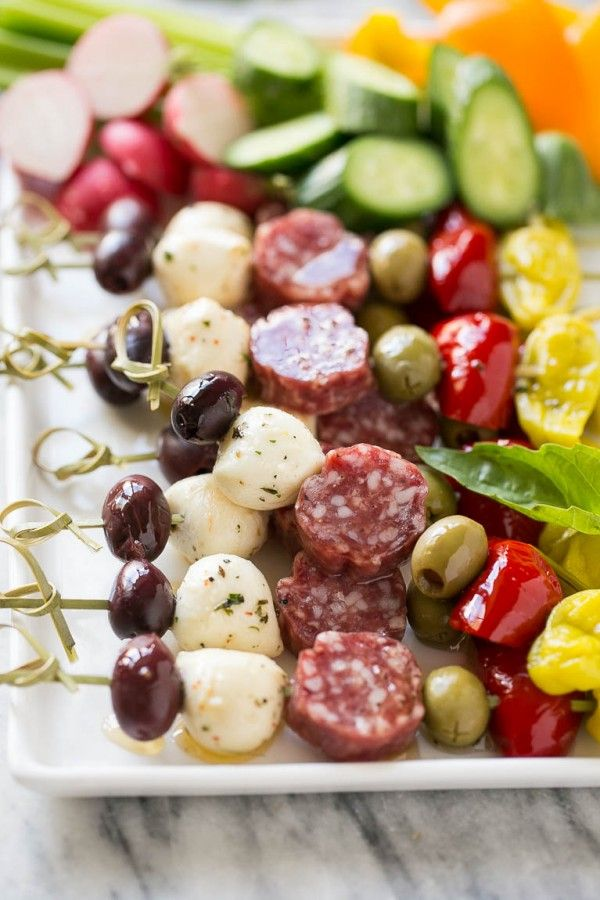 These antipasto skewers are a variety of italian meats, cheeses, olives and vegetables threaded onto sticks - an easy yet elegant appetizer.