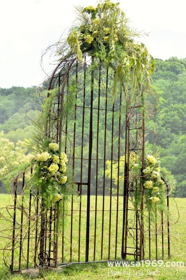Iron trellis and gate used as the ceremony backdrop at a farm wedding - Southern Accents Architectural Antiques - www.sa1969.com
