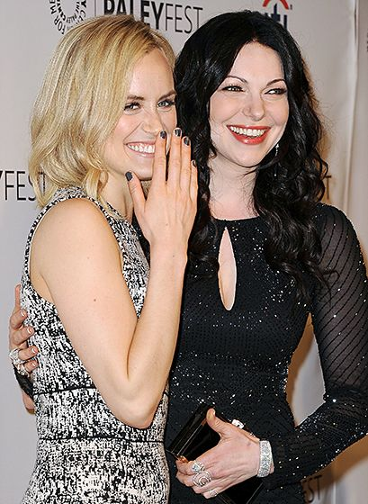 Costars Taylor Schilling and Laura Prepon are all smiles at the Orange is the New Black 2014 PaleyFest event in Hollywood on Mar. 14