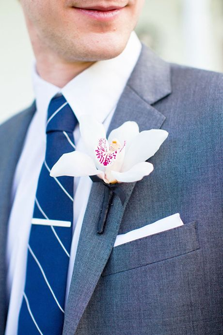 Orchid boutonniere. Simple, classic, and pretty | Brides.com