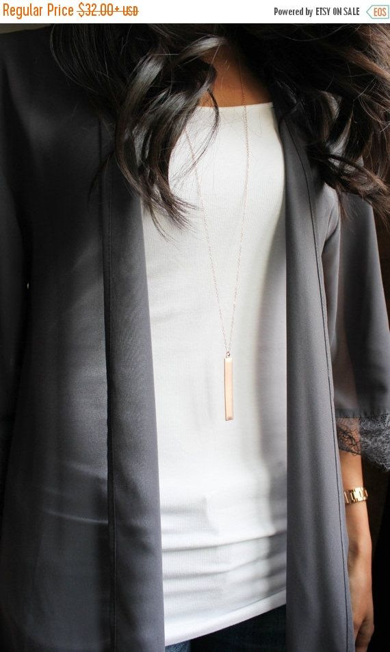 Long Necklace with Bar Brand new to my shop and one of my personal favorites :) I wear this necklace everyday and love its simplicity! It goes well with every outfit.  Length shown on model - 36 inches. If you want longer please convo me. Shorter options are available in the drop down menu when you add the item to your cart. Charm is gold/ rose gold or silver dipped and the chain and components are gold/ filled or sterling silver.  Please check out the other jewelry in my shop…