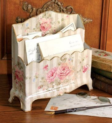"""Letter Rack & Periodical Case    Brushy florals in muted pastels are enameled upon very non-corporate home office accessories.  Metal.     Letter Rack.  10 x 9 x 3½"""".    Periodical Case.  10 x 12½ x 4""""."""