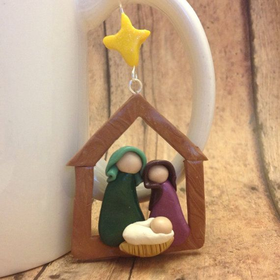 This rustic nativity scene is the perfect decoration for a traditional Christmas tree. It is handmade with polymer clay in marbled faux wood colors and green & purple or blue & pink, and finished with glaze and a touch of glitter on the star. Measures about 2 tall (3 including star) and comes with a hemp cord for hanging.