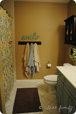Love the blue brown and yellow combo. And I like how they painted the drawers blue. This is our SAME layout