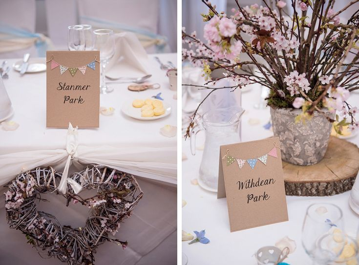 buxted park hotel spring wedding. blossom branch table centrepieces with wood slice from pollen flowers of brighton. wicker heart top table decoration from www.pollenflowers.co.uk