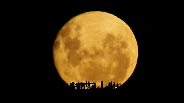Full Moon Silhouettes, A Stunning Moonrise Over New Zealand