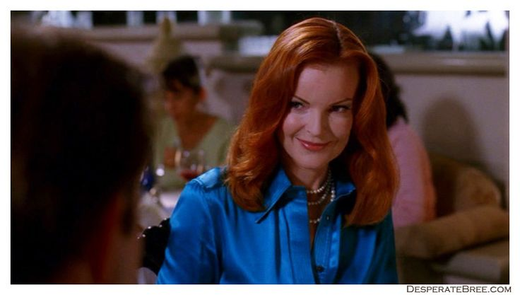 closeup bree van de kamp desperate housewives blue satin royal button up shirt at restaurant with george double row pearl necklace wavy hair blue matching makeup