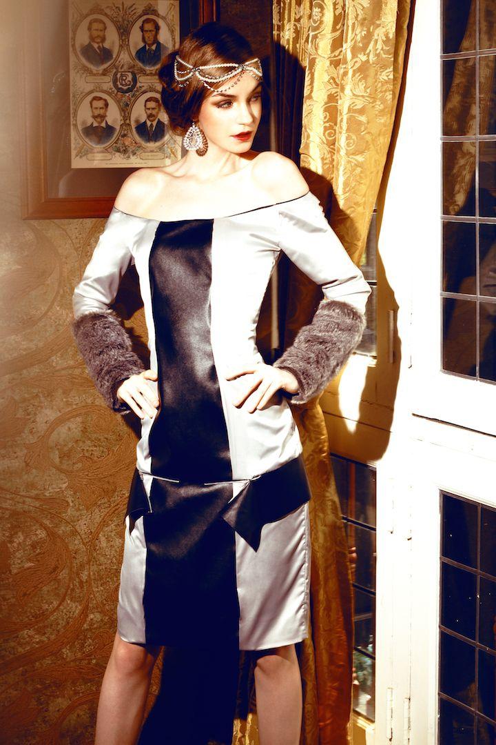 Bare shoulder dress with zip off peplum.