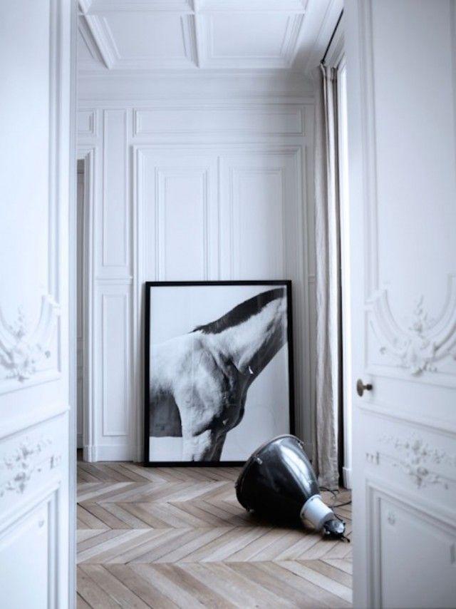 Statement art and Herringbone Wood Floors