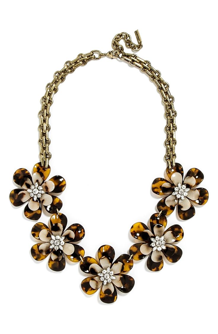 Crystal centers lend sparkling allure to the richly colored floral petals of this '60s-inspired statement necklace on a gold chain. Pair this statement piece with a sweater and jeans for an effortlessly chic ensemble.