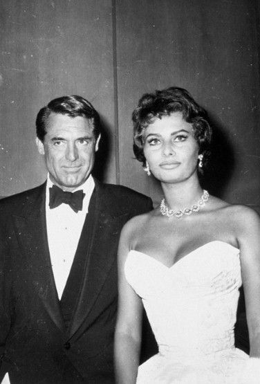 """CARY GRANT and SOPHIA LOREN on a publicity tour for """"THE PRIDE AND THE PASSION"""" (1956)."""