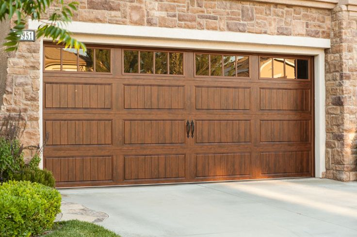 66 best images about wood look garage doors without the for Garage door faux wood finish