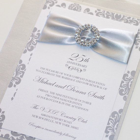25th Wedding Anniversary Invitation that makes a stunning statement perfect for an Elegent Event! The invitation is printed on White metallic cardstock, double backed with Silver Damask Print & another layer of Silver metallic Cardstock. A band of thick Silver satin ribbon is embellished with a double layer crystal silver buckle. Outer envelope in choice of Silver or White metallic. The Sample Set Includes: 1- 5 x 7 Invitation Double backed with Ribbon & Crystal Buckle 1- Outer envelope…