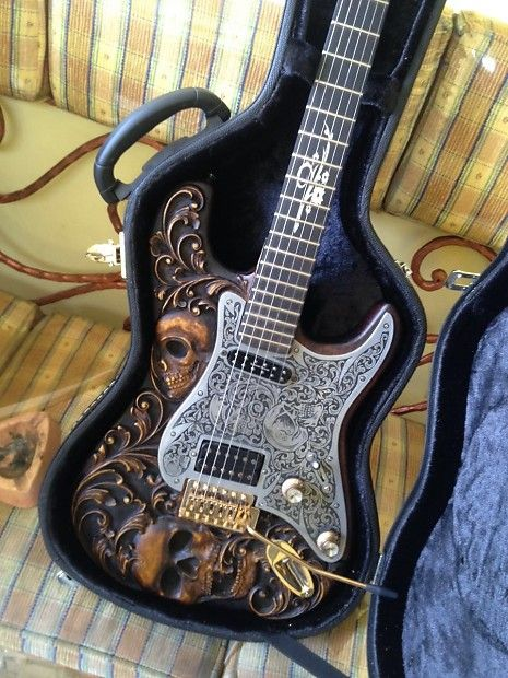 Up for sale custom stratocaster guitar.Hand carved skull on body and pickguard.Pickguard was metal engraved using hand tools.  Seymour duncan little 59 was combined with seymour duncan antiquity to create bright & crunchy sound effect. You wont be disappointed  Seymour duncan little 59  ...