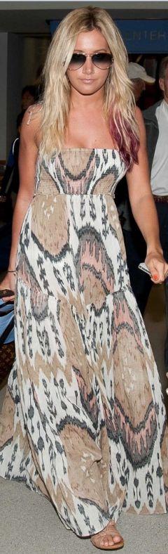 Ashley Tisdale:  Dress – AllSaints    Purse – Balenciaga    Sunglasses – Ray Ban    Suitcase – Louis Vuitton    Shoes – BC Footwear.