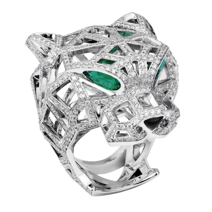 Cartier. Panthere de cartier. White gold, onyx, emerald & diamond panther ring...♡