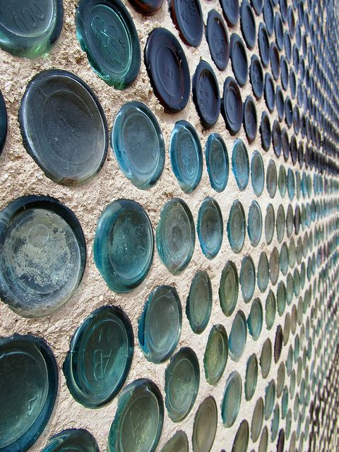 Glass bottle wall with honeycomb pattern.