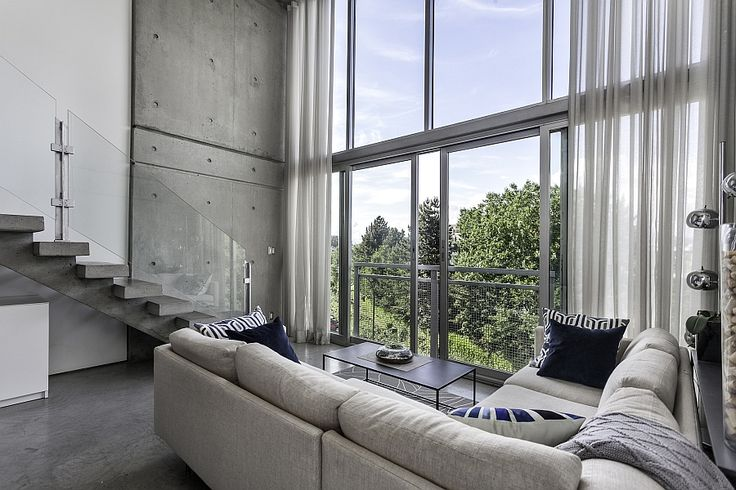Large glass sliding doors offer unabated city views Classy Customized Penthouse In Vancouver Offers A Relaxed Urban Retreat