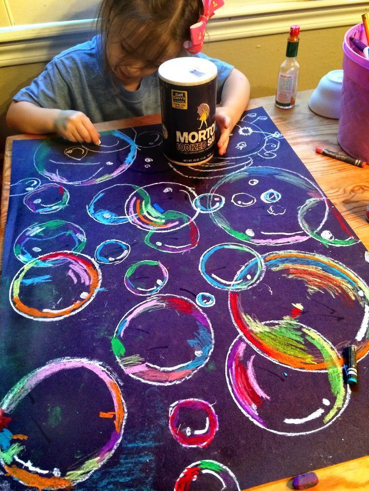 Bubbles art project for kids using oil pastels and black paper. Fun way to nurtu...