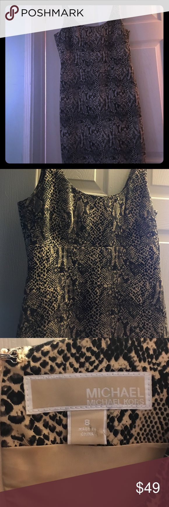 Michael Kors dress!  Must have  animal print dress I love this reptile design  dress !  Very slimming & most comfortable on a night out! very versatile with how you wear it!! Perfect condition ! Loved gently! ‼️ ZERO TOLERANCE FOR LOW BALLING! Please have respect for us all here. You will be blocked if you low ball me! Thanks! ‼️ MICHAEL Michael Kors Dresses Midi