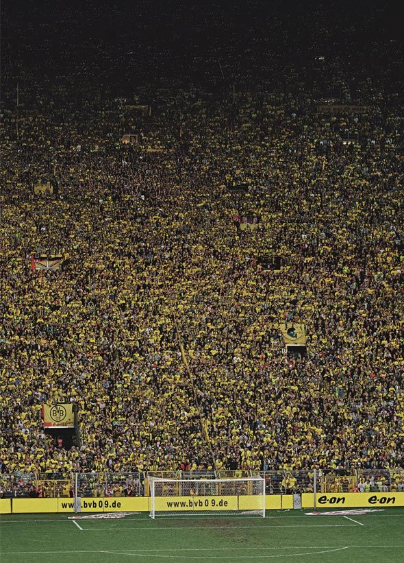 by Andreas Gursky This shows the disorder of the crowds in a football game I believe this captures the spirit of a crowded football match.
