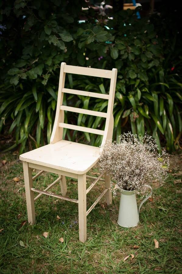 Old Wooden Chair And A Vase Of Babyu0027s Breathe Make A Statement For A Rustic  Wedding