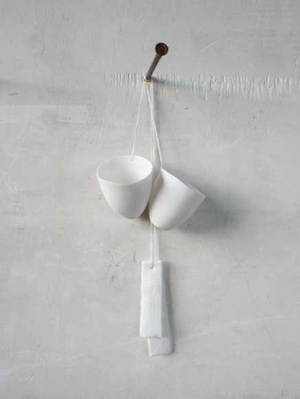 bone china hanging egg cup by Caroline Swift