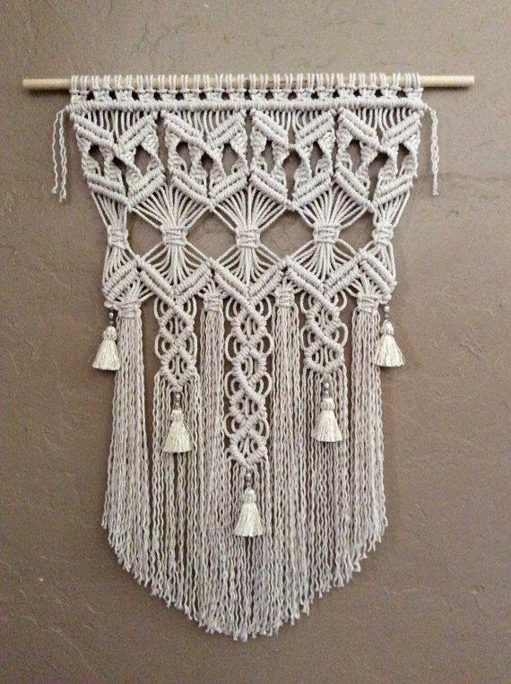 First designs are always special, and this was my very first. Then I added tassels and silver beads and a new beauty was made. I created this beautiful Macrame Wall Hanging to be hung outside as Garden Art or in your window or beautifully inside as a Wall Tapestry. No matter where you place it, your home will be enriched with that fabulous bohemian look.   Handmade and original design by Lucy Lanuza  🔹🔹🔹🔹🔹🔹 1/8 soft cotton rope  Size is approximately: Wooden dowel length- 23 Macrame wid...