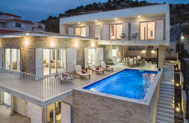 Arcadia.  Set right beside a rocky beach and tiered into the hillside for fabulous views across the bay, this is a very contemporary luxury villa in Croatia, well planned for both indoor and outdoor living.