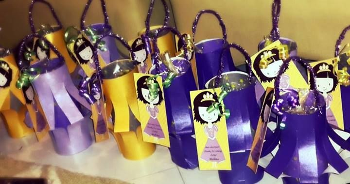 the goody bags DIY lanterns. Made out of gift paper in purple and yellow. and putting a pouch of goodies inside. Loved by all...:)