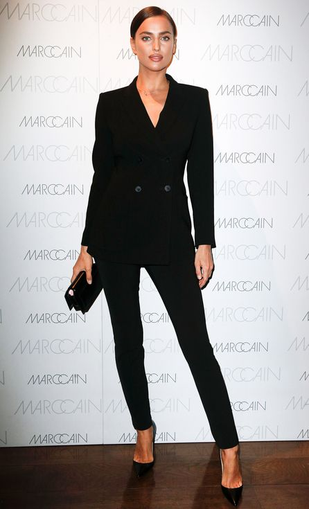 Irina Shayk in a black double-breasted suit and heels