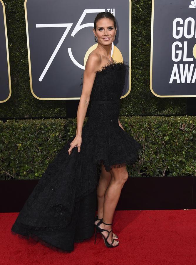 Heidi Klum, impresionante con un vestido 'tail hem' con falda de volumen firmado por Ashi Studio.