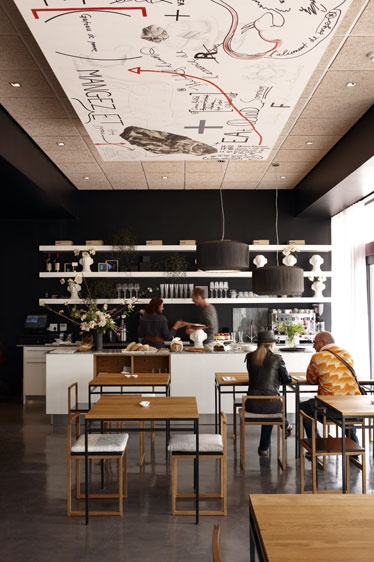 Hemelhuijs - Cape Town. Like the black wall with white shelving and the wood furniture added into the mix. Ceiling looks interesting.