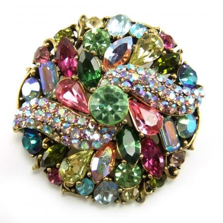 1957 vintage rhinestone brooch.   worn by my grandmas,  I still have some as Christmas ornaments....df