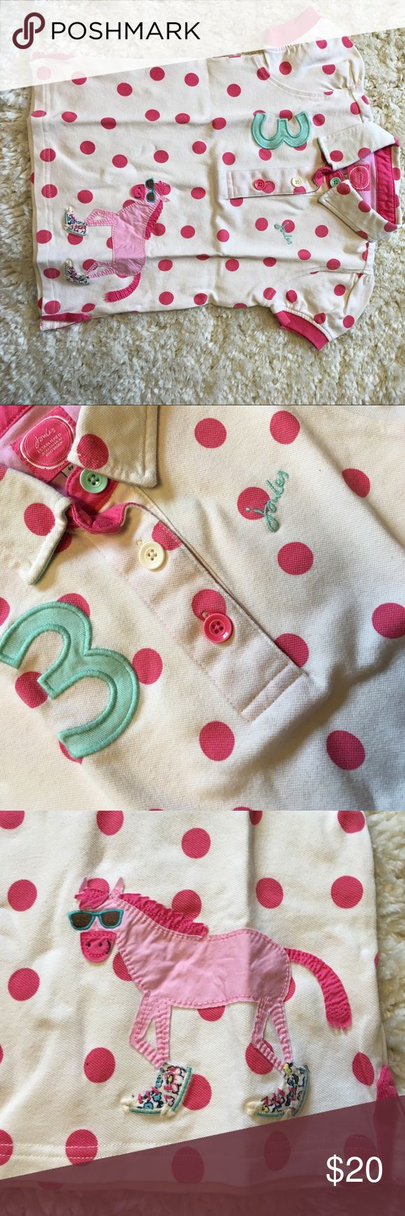 Joules Polo Shirt Girls-6 Isn't this darling? This Joules Girls polo, size 6, is a short sleeve with 3 buttons (different colors), a cream color with pink accents and Polka dots, a 3 patch, embroidered joules, and a Zebra patch on the bottom. Soo cute! Great condition. Joules Shirts & Tops Polos