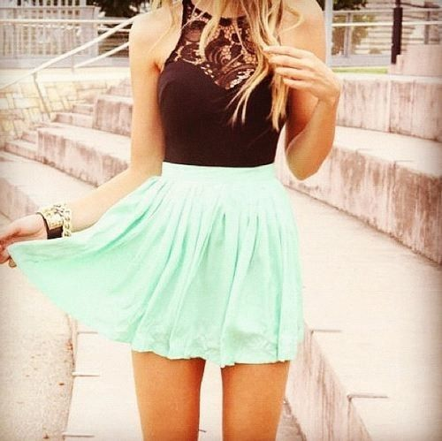 back laced shirt and high waisted turquoise skirt .