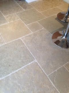 The beautiful sage green and sandy tones throughout the Jaipur Brushed Limestone make this flagstone the perfect choice for a family kitchen.