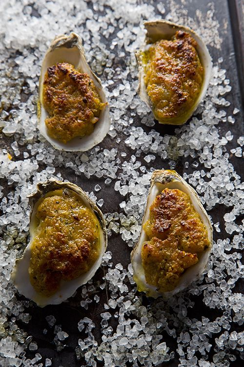 New Orleans is an oyster lover's town: They're emblematic, hungrily sought after, and seemingly everywhere. Whether deep-fried and served atop a zesty, garlicky sauce, smothered in puréed greens, or topped with Parmesan and broiled, these oyster recipes make perfect party plates for any occasion.