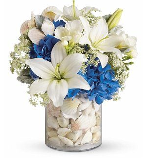 Seashell Flower Arrangement, for Spring or summer display- interchange from cooler colors in the summer and warmer, brighter colors for the winter: No Winter Blues