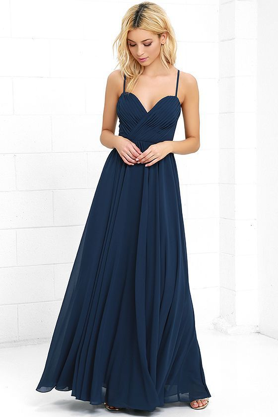 Putting on the Nod and Wink Navy Blue Maxi Dress is the start to every great romance! Adjustable spaghetti straps support a gathered surplice bodice (with modesty stitch) while a full, woven maxi skirt sways below. Hidden back zipper with clasp.