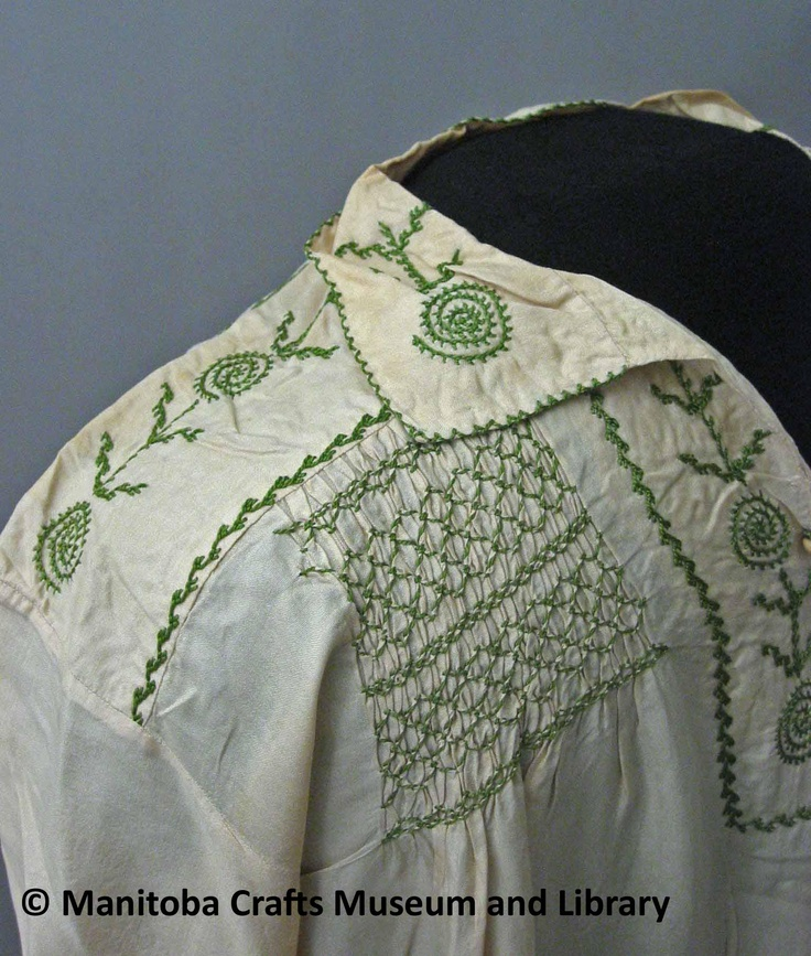 Detail: Pongee silk with V neck and 4 buttons. Embroidery on collar and yoke. Two pockets with same embrodiery (leaf and spiral) embroidered across back shoulder. Smocking on front shoulders and middle of back.
