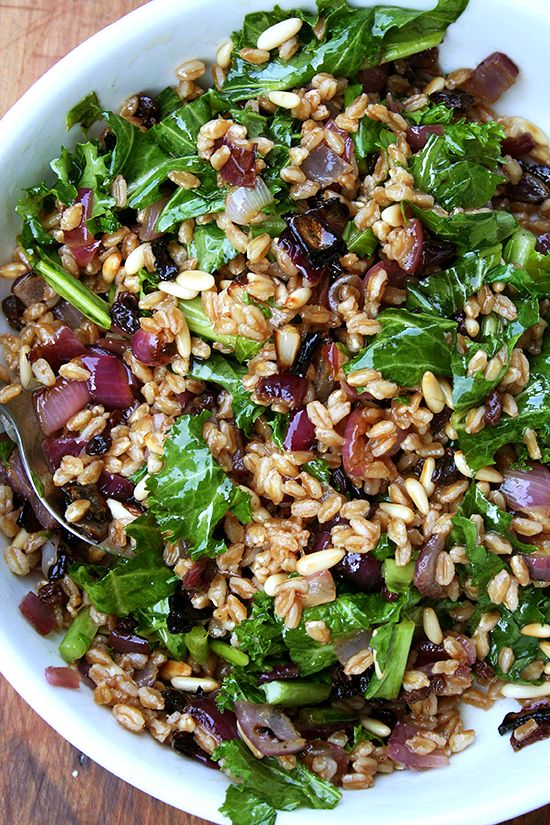 FARRO SALAD WITH TOASTED PINE NUTS, CURRANTS & MUSTARD GREENS - Farro, when surrounded by all the elements of the Zuni salad — sweet onions, crunchy nuts, spicy greens, a simple olive oil and vinegar dressing — soaks up so much goodness all the while maintaining its chewy texture and nutty flavor.