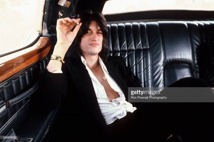 Aerosmith guitarist Joe Perry poses for a portrait in the back of a limo in 1978.