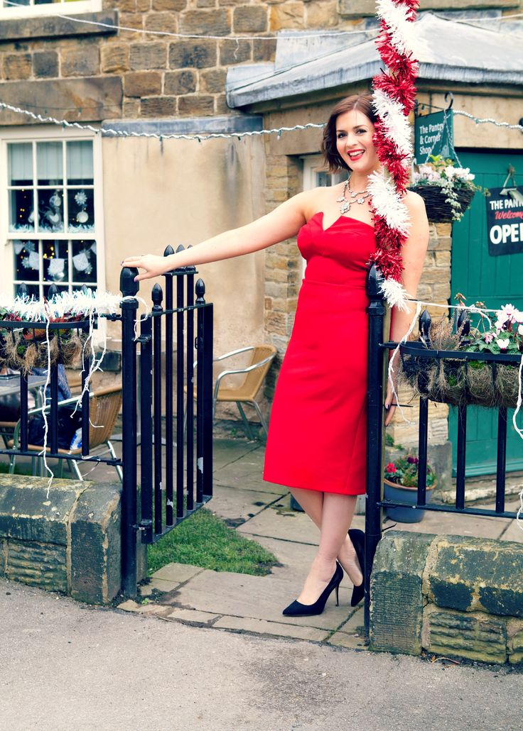 Red dress. Very festive!   http://www.poutinginheels.com/making-a-jewellery-statement-this-christmas/  #reddress #redstraplessdress #glamorousreddress