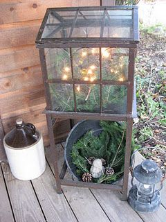 Repurposed old windows filled with greens and lights