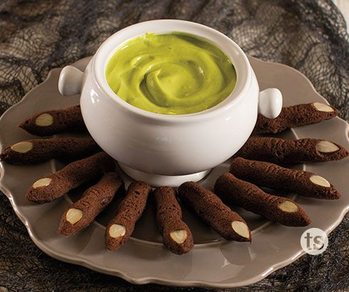 Ghoulish Fondue with Chocolate Fingers Recipe│Creepy fingers made from chocolate cake mix with an almond. Dipped in green fondue for a delicious Halloween appetizer.