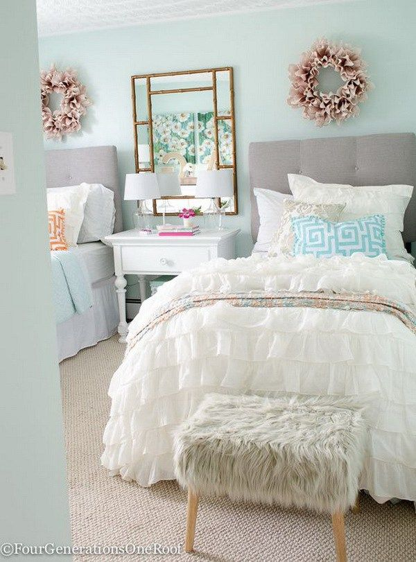 Sophisticated teenage girls bedroom. Fabulous neutral color palette, light green walls and a white, blue and pink color scheme.