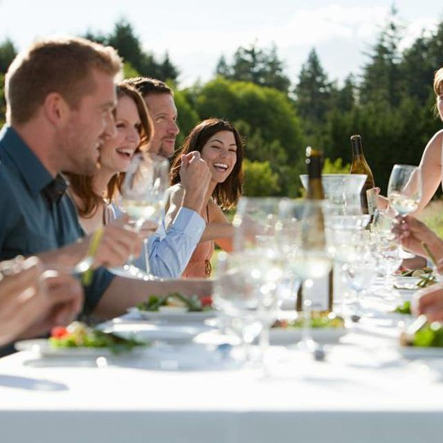 Friends enjoying five-course dinner meal outside